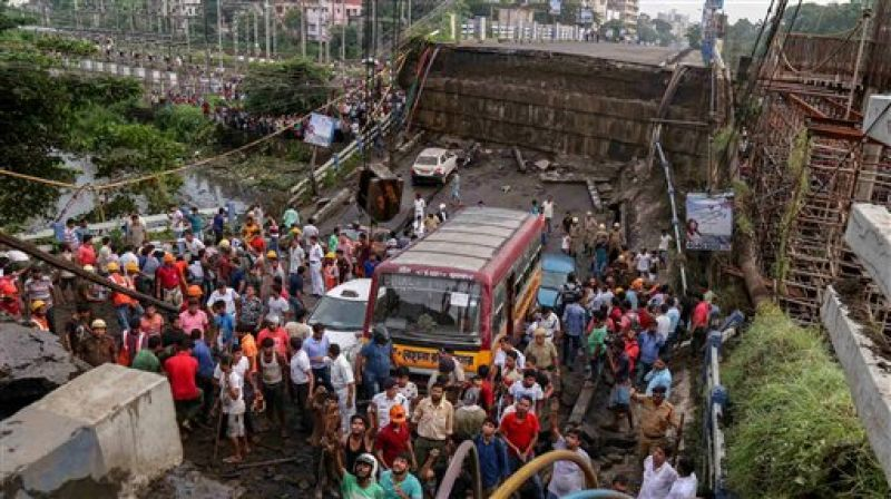 Vehicles are seen stuck after a section of Majerhat bridge collapsed in Kolkata, Tuesday. (Photo: PTI)