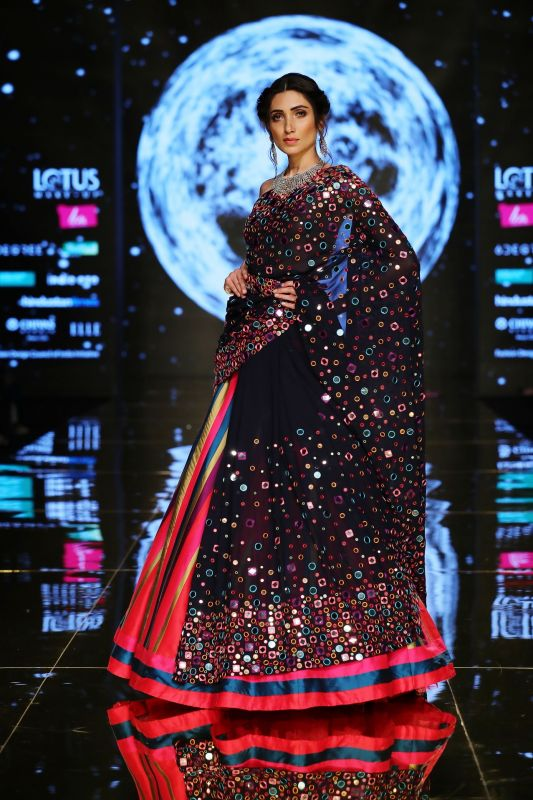 Abstract mirror work makes the lehenga look bright and beautiful. (Photo: FDCI)