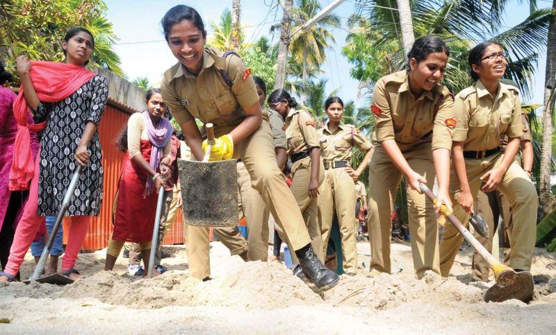 NCC cadets and NSS members of St Teresa's College engaged in relief operations at Chellanam. (Photo: DC)