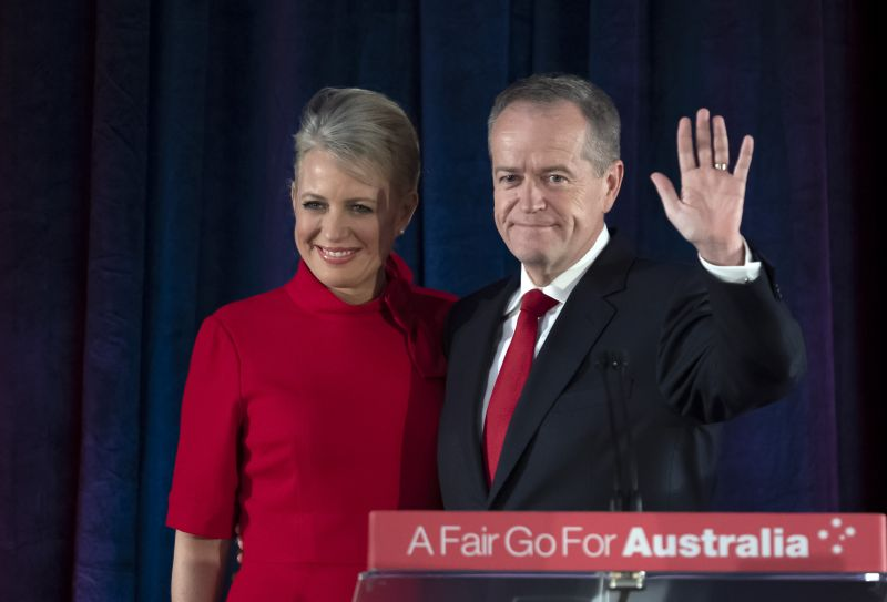 Australian Labor leader Bill Shorten stands on stage with his wife Chloe, at the Federal Labor Reception in Melbourne, Australia, Saturday, May 18, 2019. Shorten has conceded defeat to Prime Minister Scott Morrison in the country's general election. Shorten made the announcement to supporters of his opposition Labor party late Saturday night in Melbourne. (AP Photo/Andy Brownbill)