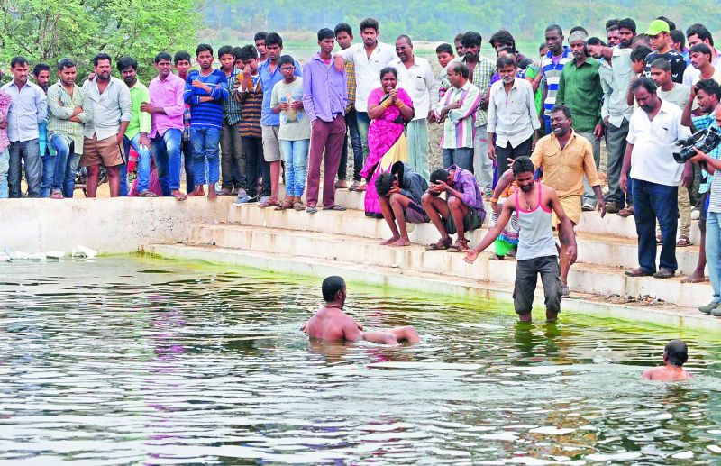 Police recovers the body of M. Vikas from the Bathukamma Ghat on Necklace Road. Vikas and three of his friends had gone to the Ghat to swim. (Photo: DC)