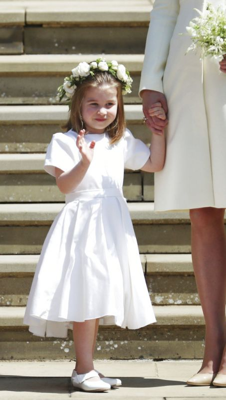 Princess Charlotte waves to Meghan Markle and Britain's Prince Harry on the steps of St George's Chapel at Windsor Castle following their wedding in Windsor. (Photo: AP)