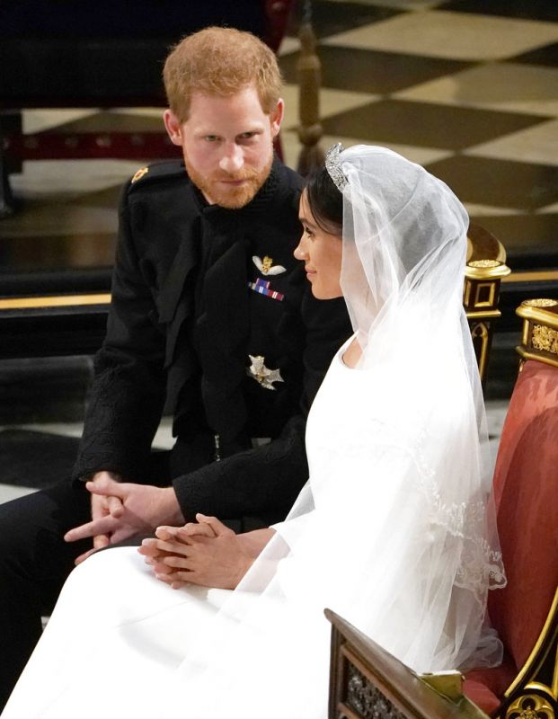Britain's Prince Harry and Meghan Markle during their wedding at St. George's Chapel in Windsor Castle in Windsor, near London, England, Saturday, May 19, 2018.  (Photo: AP)