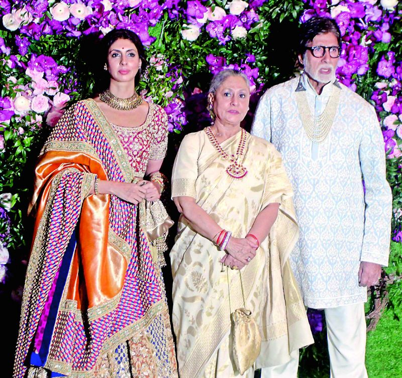Curiously, the wedding also saw two huge Bollywood icons — Amitabh Bachchan and Shah Rukh Khan — sporting pearl necklace for the event... something neither have done before.