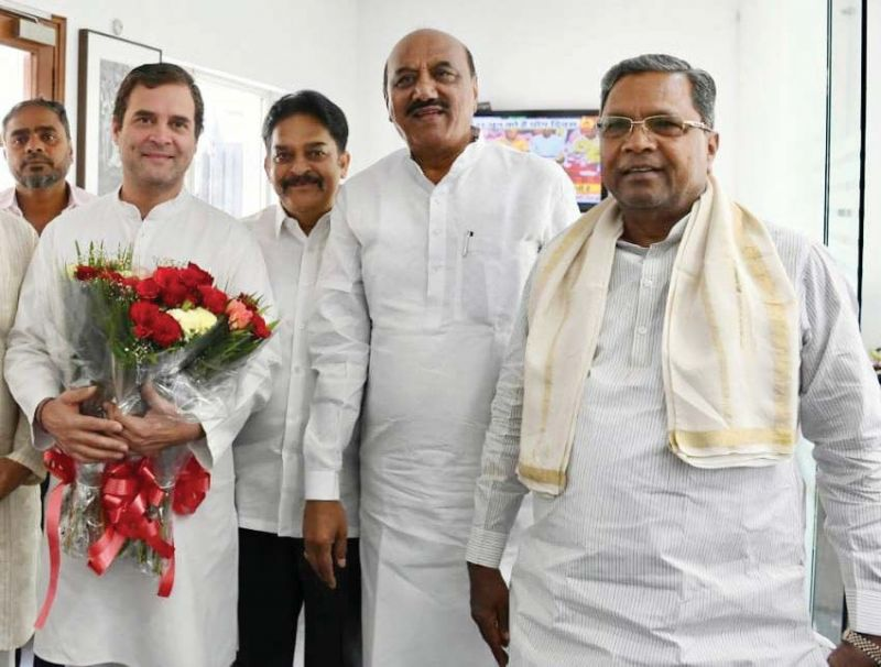 Former CM Siddaramaiah greets AICC President Rahul Gandhi on his birthday in New Delhi on Wednesday. (Inset) Minister D.K. Shivakumar also wished him. (Photo: DC)