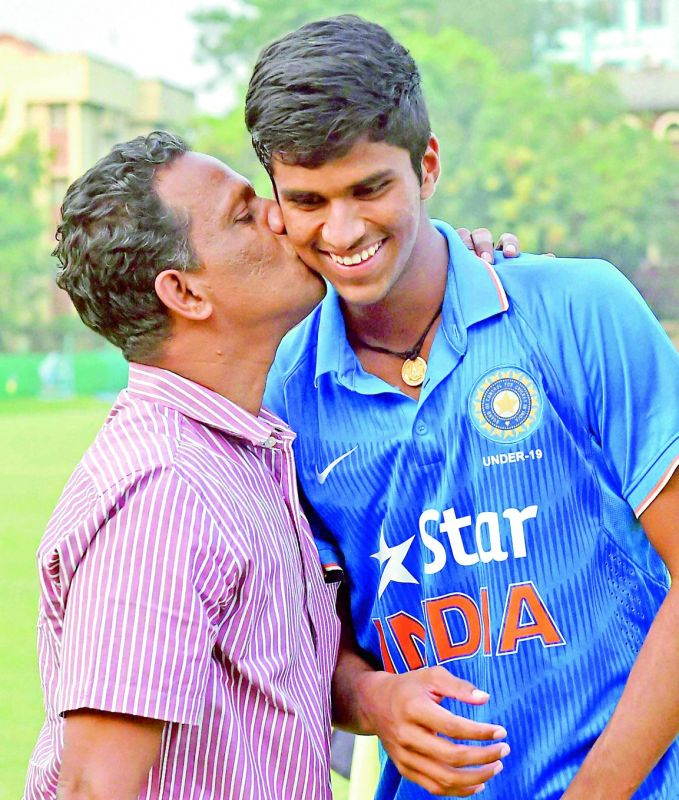 Washington with his father after the win against Bangladesh during U-19 Tri-series Cricket Tournament in Kolkata