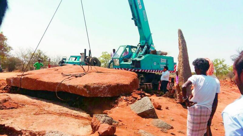 The crane from Hyderabad took four hours to lift the 40 ton capstone.