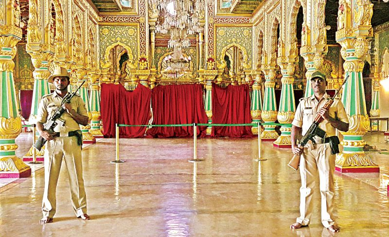 Policemen guard the Golden Throne which has been assembled for the private darbar of the scion of the Mysuru royal family during the Dasara festivities