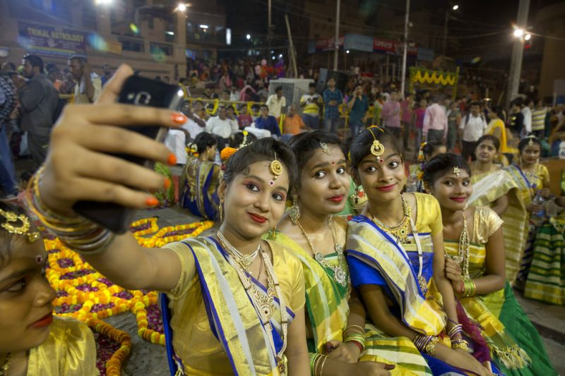 Indian girls take a selfie after participating in rituals on the occasion of Ganga Dussehra festival in Varanasi, India, Thursday, May 24, 2018. Hindus across the country celebrate Ganga Dussehra by worshiping the River Ganges, which is considered the most sacred and the holiest river for Hindus. (AP)