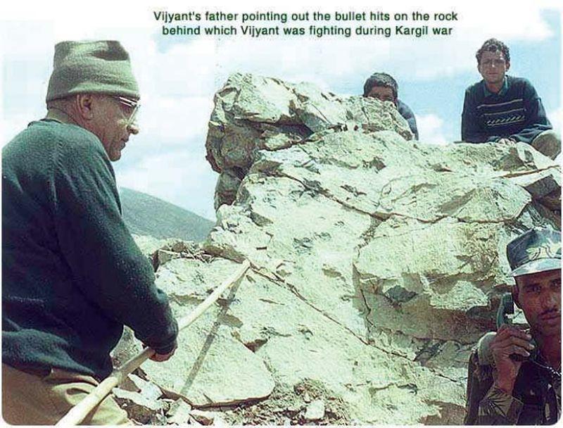 Col.(retd) V.N.Thapar shows the bullet marks on the rocks behind which Vijayant Thapar died during  the Kargil war