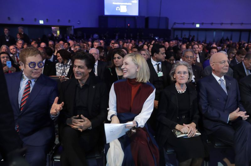 Shah Rukh Khan with British musician Elton John, Australian actress Cate Blanchett, Hilde Schwab, Chairwoman and Co-Founder of the World Economic Forum's World Arts Forum, and WEF founder Klaus Schwab, from left, wait for the ceremony for the Crystal Awards on the eve of annual meeting of the World Economic Forum in Davos. (Photo: AP)