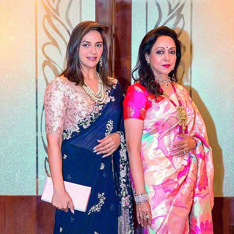 Hema Malini put up a picture on Instagram after attending Isha Ambani's wedding, crediting @warp and Weft for the saree she was wearing