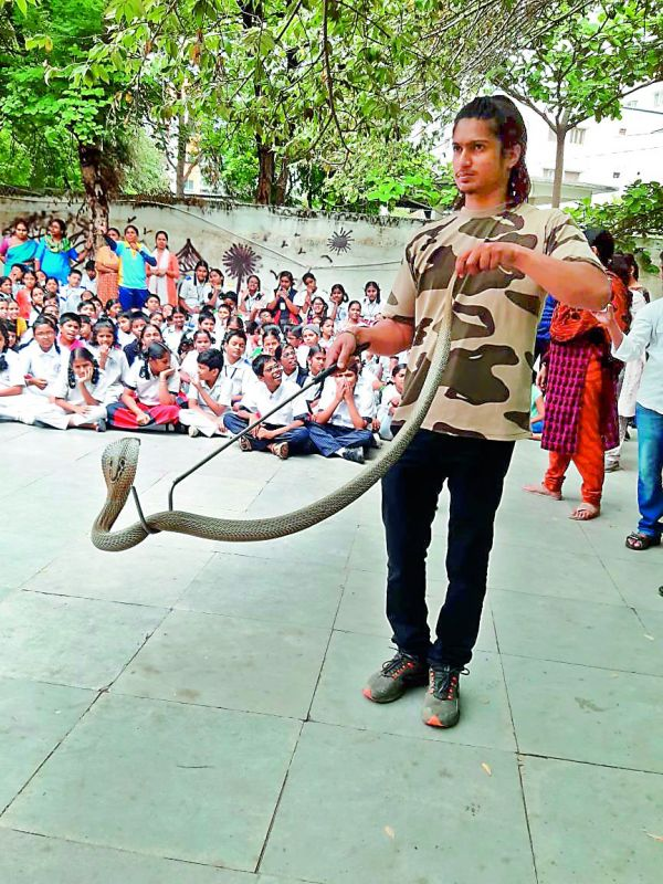 Abhishek from Friends of Snakes Society during an awareness porgramme
