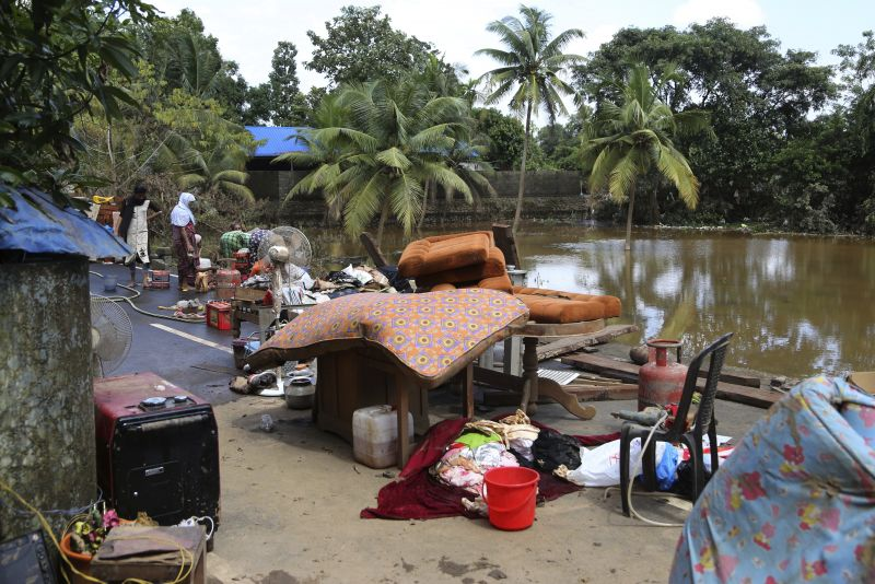 Household goods are placed on road to dry after being salvaged by residents from their flood affected houses on the outskirts of Kochi. (Photo: AP)