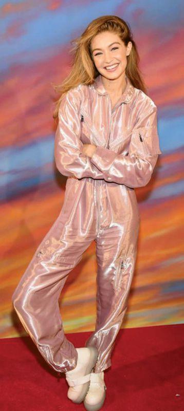 Gigi Hadid in Pink shiny boiler suit