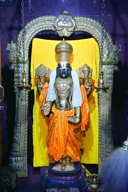 Standing tall: The idol of Lord Venkateswara, which is from Tirupathi while the brass body armour is from a devotee. (Photo: DC)