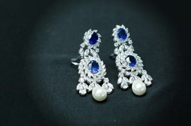 Studded earrings by Diosa Jewels
