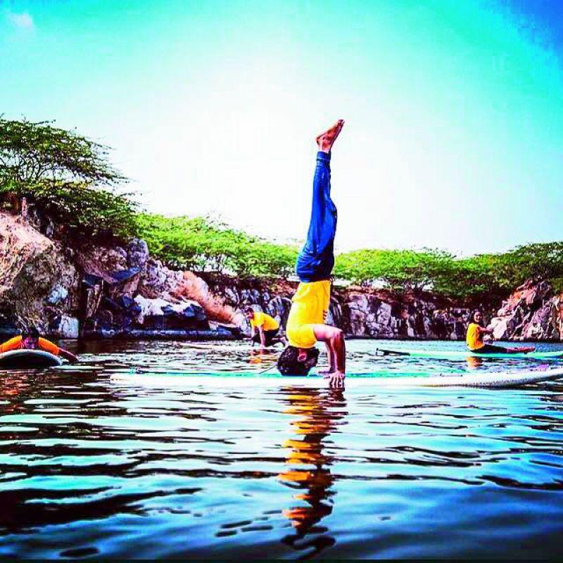 paddle yoga: Sarvesh Shashi, the founder of Zorba Studios does a Sirasana on a paddle boat