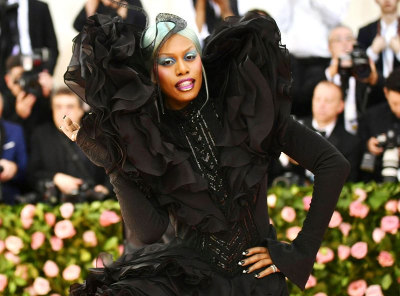 Laverne Cox attended 2019 The Met gala dressed in a striking sculptural gown by Christian Siriano, along with turquoise hair. (Photo: AP)
