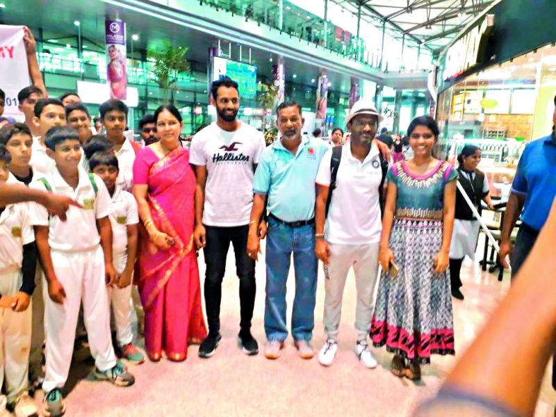 Vihari (fourth from right) is all smiles as he poses with his mother Vijayalakshmi (in red saree), coach John Manoj (third from right), Team India fielding coach R. Sridhar (second from right) and sister Vaishnavi (right) at the airport.