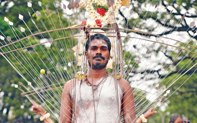 "A devotee with his body pierced with metal rods  performs a ritual during ""Aadi"" celebrations in Chennai on Sunday. (Photo: AFP)"