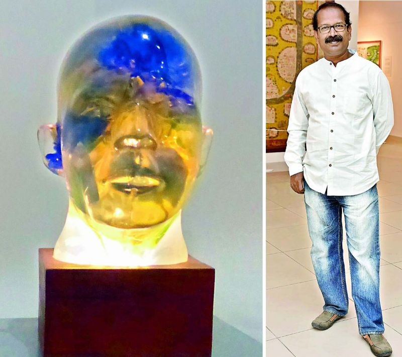 A striking sculpture in mixed media by Chippa Sudhakar is a composed head that's lit up intrinsically from the lower section.