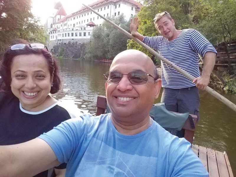Sandeep and Shailaja on the boat cruise with an enthusiastic oarsman and guide.
