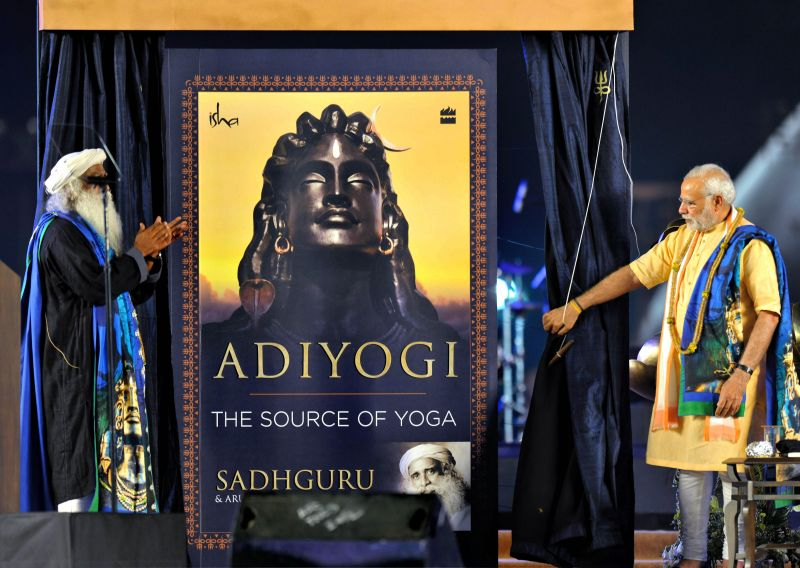 Prime Minister Narendra Modi with Sadhguru Jaggi Vasudev releases a book on Adiyogi during the unveiling function of 112-feet iconic statue of Adiyogi Lord Shiva at Isha Foundation in Coimbatore on the occasion of Maha Shivratri. (Photo: PTI)