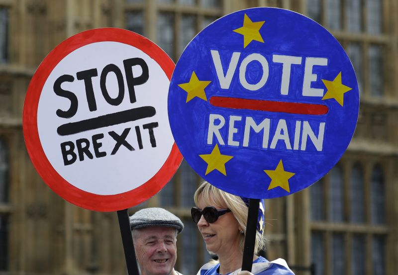 Anti Brexit campaigners hold banners near Parliament in London, Wednesday, May 22, 2019. British Prime Minister Theresa May was under pressure Wednesday to scrap a planned vote on her tattered Brexit blueprint and to call an end to her embattled premiership after her attempt at compromise got the thumbs-down from both her own Conservative Party and opposition lawmakers. (AP Photo/Kirsty Wigglesworth)