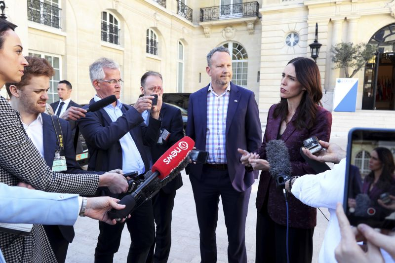 New Zealand Prime Minister Jacinda Ardern, right, gives a press conference, at the OECD headquarters, in Paris, Tuesday, May 14, 2019. The leaders of France and New Zealand will make a joint push to eliminate acts of violent extremism from being shown online, in a meeting with tech leaders in Paris on Wednesday. (AP Photo/Thibault Camus)