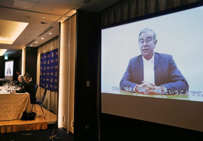 Former Nissan chairman Carlos Ghosn, seen on a screen, speaks in a video during a press conference held by his lawyers in Tokyo