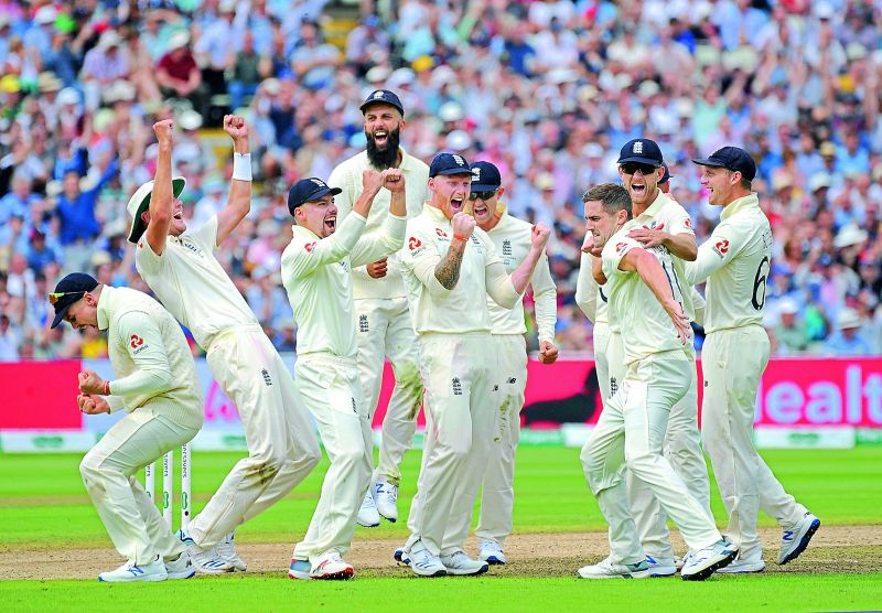 England cricketers celebrate after a successful review decision for the dismissal of Australian batsman Matthew Wade during the first day of the first Ashes Test at Edgbaston ground in Birmingham, England, on Thursday. (Photo: AP)