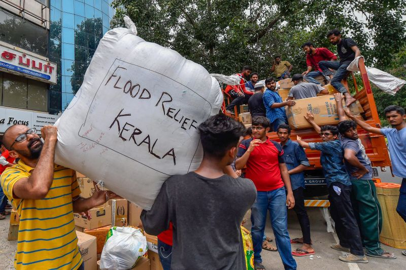 Volunteers segregate flood relief material donated by general public to be sent to Kerala, in Chennai on Sunday. (Photo: PTI)