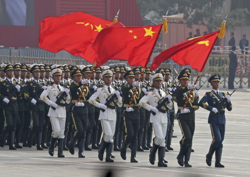 Chinese solders march during a parade to commemorate the 70th anniversary of the founding of Communist China in Beijing. (Photo: AP)