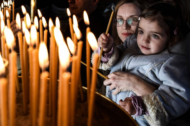 Greek Orthodox believers light candles during Good Friday's 'Apokathelosis', the lowering of Christ's dead body from the Cross, which forms a key part of Orthodox Easter, at Pendeli monastery, north of Athens, on April 6, 2018. Millions of Greeks flock to churches around the country this week to celebrate Easter, the country's foremost religious celebration. (Photo: AFP)
