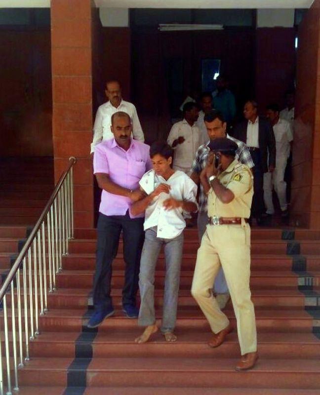 Attacker Tejas Sharma who stabbed the Karnataka Lokayukta Justice Vishwanath Shetty at his office in Bengaluru has been taken into custody by the police. (Photo: ANI | Twitter)
