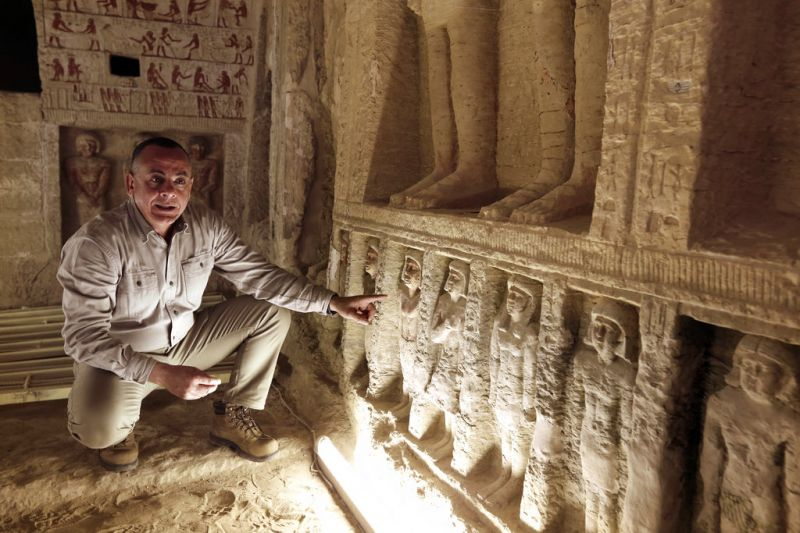 Mostafa Waziri, secretary general of the Supreme Council of Antiquities, speaks inside a recently uncovered tomb of the Priest royal Purification during the reign of King Nefer Ir-Ka-Re. (Photo: AP)