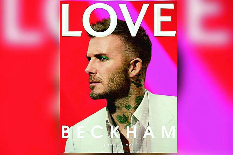 Former footballer David Beckham sporting green eyeliners for the cover of Love Magazine.