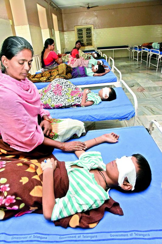 Mothers attend to their children who suffered injuries while celebrating Diwali in Hyderabad on Friday. Many children who suffered eye injuries while bursting crackers were admitted to the  Sarojini Eye Hospital on Friday. (Photo: P.Surendra)