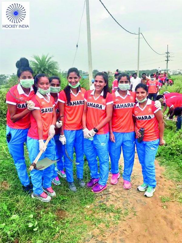 cleanliness is everything: Members of the women's hockey team during the Swachh Bharat Abhiyan campaign in Bengaluru recently.