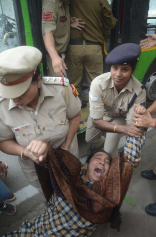 Najeeb Ahmed's mother being dragged away by Delhi police. (Photo: Twitter)