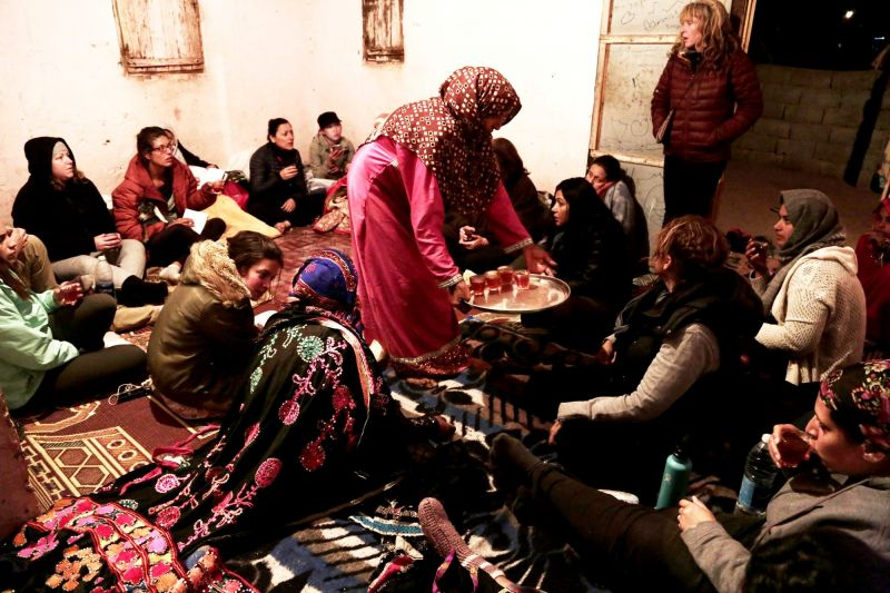 Umm Yasser offers tea to women's only circle of tourists and Bedouin from the Hamada tribe, at her home in Wadi Sahw, South Sinai, Egypt. (Photo: AP)