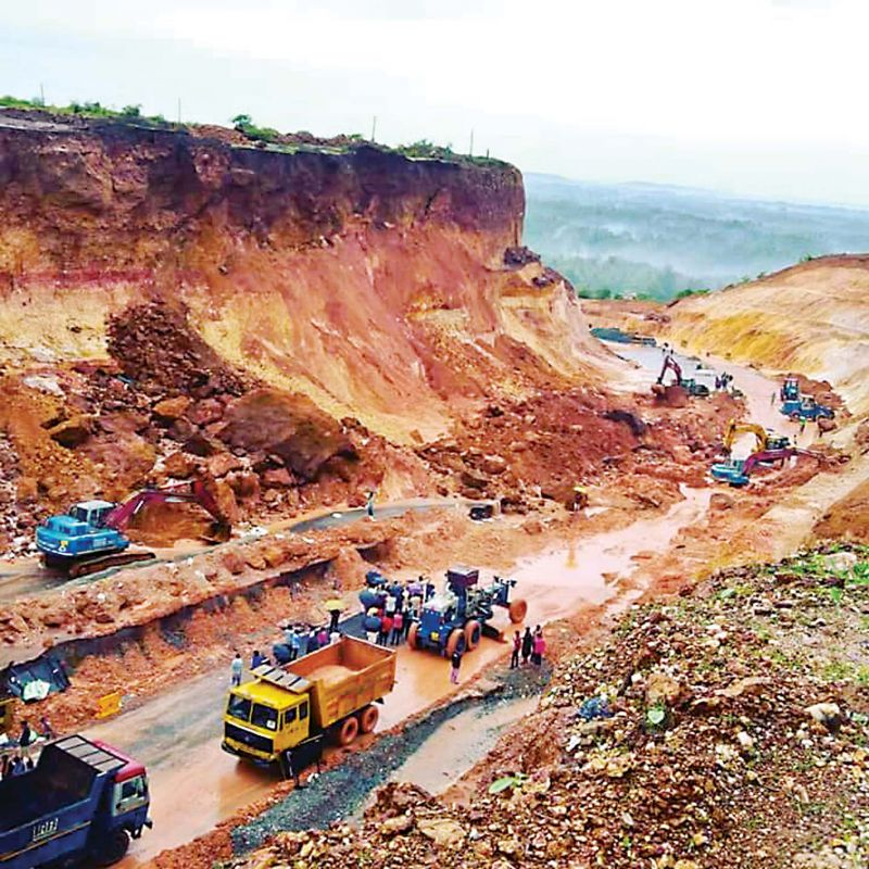 Workers clear the National Highway 66 which was blocked after a landslide near Kumta on Sunday. (Photo: KPN)