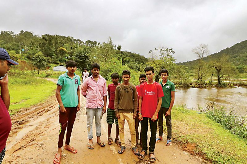 Mahesh (second from left) and his friends saved four women and a child