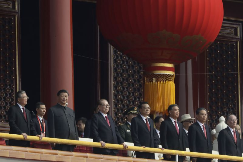 Chinese President Xi Jinping, third from left, stands with other Chinese leaders to watch a parade as Communist Party celebrates its 70th anniversary in Beijing. (Photo: AP)