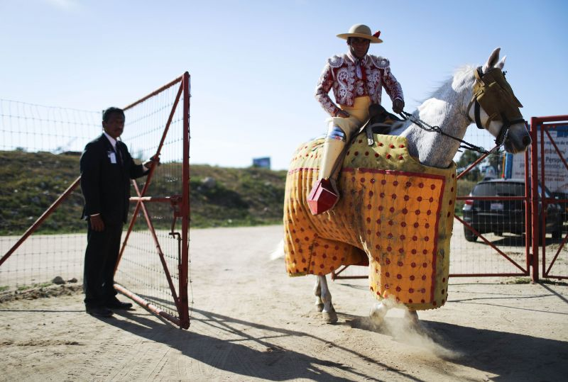 A horseman prepares to enter the ring at a sold-out bullfight on April 8, 2018 in Tijuana, Mexico.  Children are permitted to watch the spectacle only if they are supervised by an adult.(Photo: AFP)