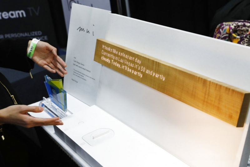 The mui calm design device is on display at the mui booth during CES Unveiled at CES International, Sunday, Jan. 6, 2019, in Las Vegas. The interactive device allows the user to control devices such as home lighting and thermostats via touch and voice command. (AP Photo/John Locher)
