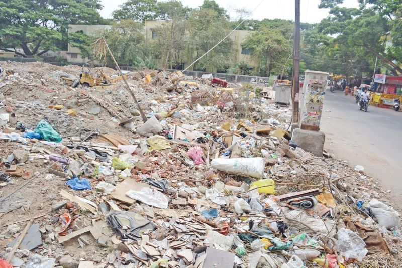 Construction debris dumped in the open ground adjoining the school. (Photo: DC)