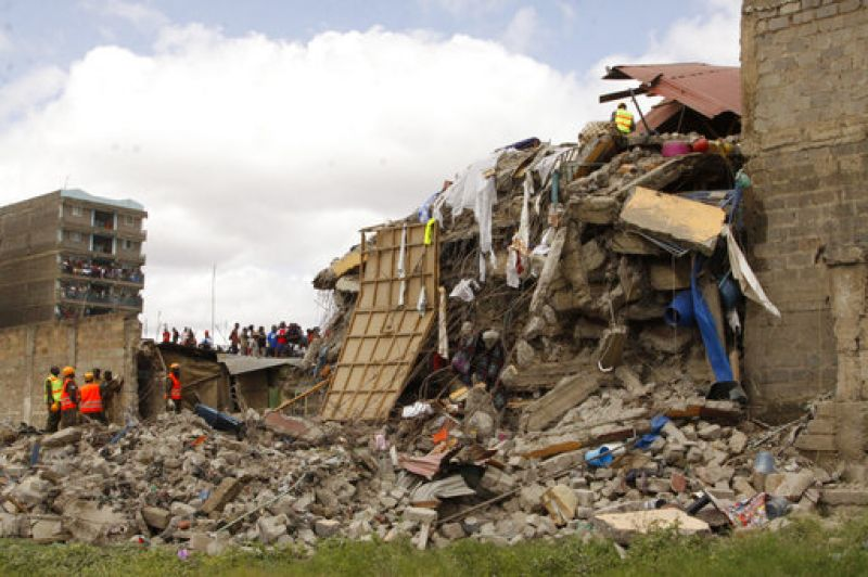 Rescuers work at the site of a building collapse in Nairobi, Kenya Tuesday. Nairobi Police Chief Japheth Koome said Tuesday that at least 10 people had been reported missing after the collapse Monday night.