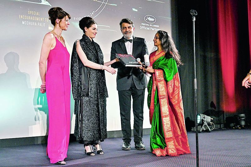 Modhura Palit while receiving award at Cannes Film Festival.